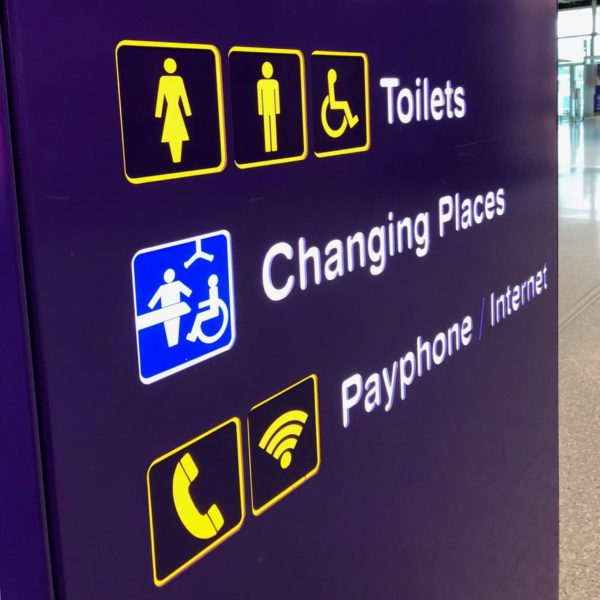 A purple sign highlighting a Changing Places toilet, baby changing facilities and gender-specific toilet cubicles.