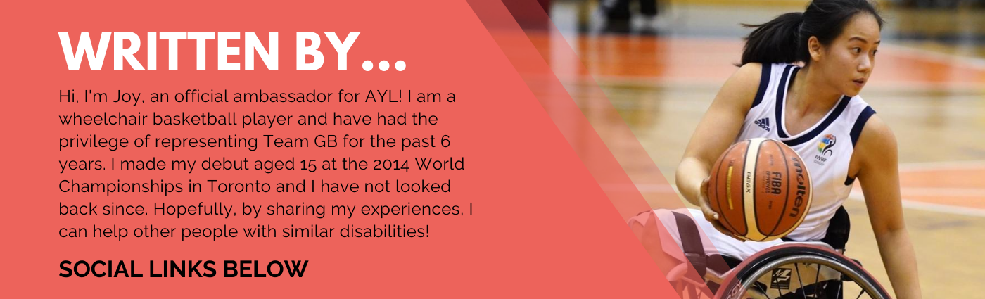 A coral banner with information on the writer of this blog - Joy Haizelden! Along with an image of Joy sitting in a sports wheelchair playing basketball.