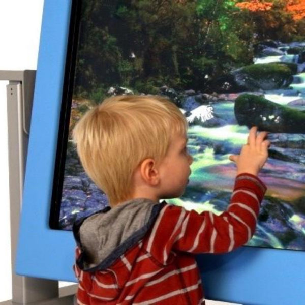A young child using an interactive sensory screen called VisiLift+.