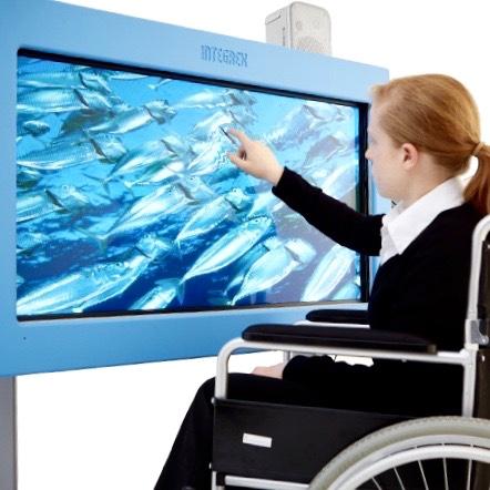 A child using an interactive sensory screen called VisiLift.