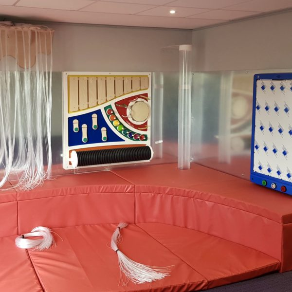An immersive room with sensory lights, interactive games and colourful soft padded floors.