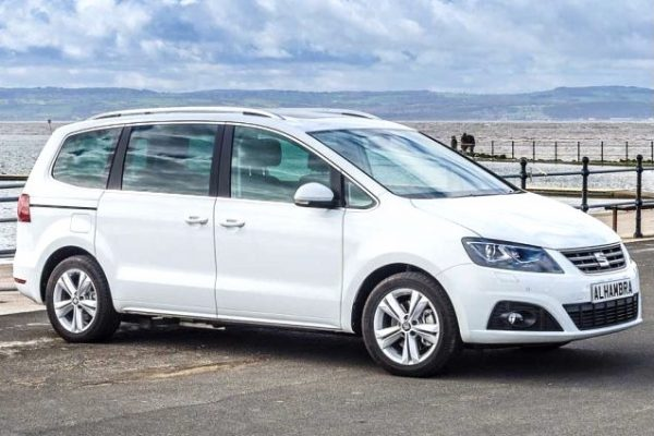 White Seat Alhambra parked sideways on the seafront.