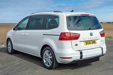 White Seat Alhambra with deployed wheelchair access ramp parked on the seafront.