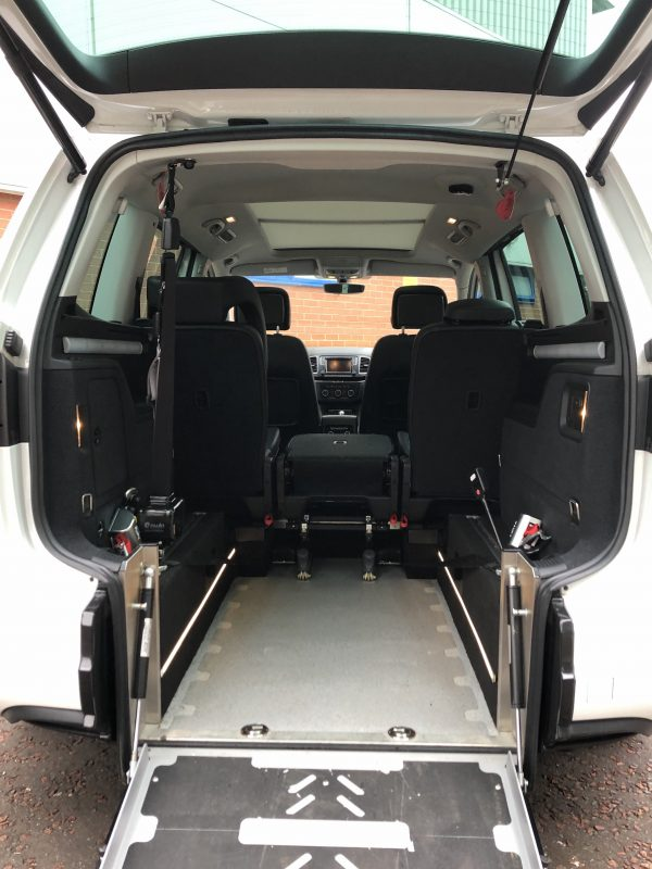 White Seat Alhambra with deployed wheelchair access ramp.