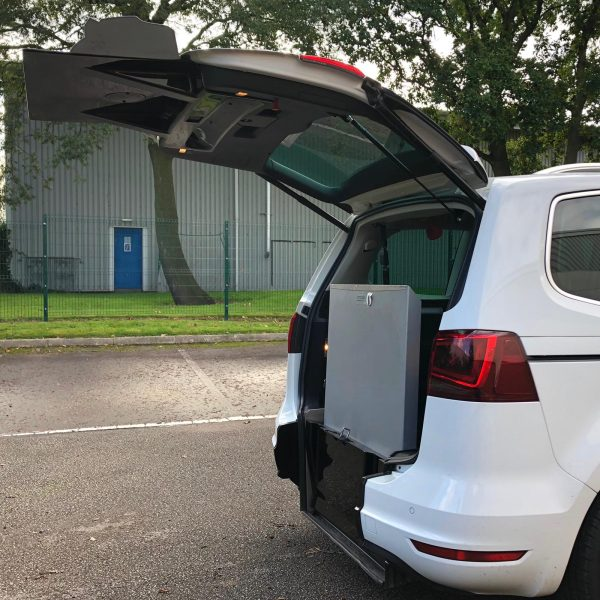 White Seat Alhambra with an opened boot and folded wheelchair access ramp.