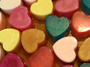 A selection of multicoloured heart shaped soaps.